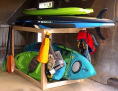 Plans to build an extremely simple but useful kayak and/or SUP (stand-up paddleboard) storage rack. No fancy cuts, this piece is simply a rectangle frame made with 2 x 4's and 4 x 4's, wood glue, and pocket screws. Add hooks to organize your paddling accessories. This is a great beginner project.