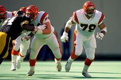 Anthony Munoz (OT) - A QB's best friend.  He made the pro-bowl 11 consecutive years from 1981-1991.
