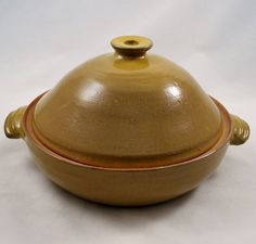 Interesting idea. has a small hole in the middle presumably to allow the water from the pan to enter and steam the veggies.  Vegetable or Rice Steamer/Wheel Thrown Stoneware Pottery