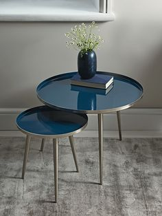 Crafted from sturdy powder coated iron with a deep blue, glossy enamel top, our unique side tables will make a Scandi inspired statement in your living space. The perfect occasional surface for your home, their slender,nickle legs create an elegant silhouette.