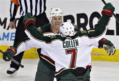 Minnesota Wild's Matt Cullen (7) and Kyle Brodziak (21) celebrate Cullen's goal on the Edmonton Oilers during third period NHL hockey action in Edmonton, Alberta, on Thursday Feb. 21, 2013. (AP Photo/THE CANADIAN PRESS,Jason Franson)