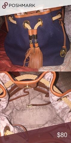 Michael Kors tote Round Michael Kors tote in navy blue twill fabric with brown leather trim. Used in really good condition. Michael Kors Bags Totes
