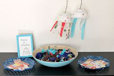 Scrap ribbon, stickers and leftover disposable bowls make jellyfish!