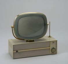 Predicta Television, 1959; Designed by Severin Jonassen and Richard Whipple; USA; metal, glass, molded plastic; H x W x D: 62.2 x 62.5 x 27.3 cm (24 1/2 x 24 5/8 x 10 3/4 in.); Gift of Jan Staller in honor of Max Staller; 2008-29-1