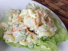 Hawaiian Potato Salad Recipe Salads with dressing, mayonnaise, pickle juice, mustard, salad, potatoes, macaroni, shredded carrots, green onions, hard-boiled egg, frozen peas, sea salt, ground pepper, sweet pickle