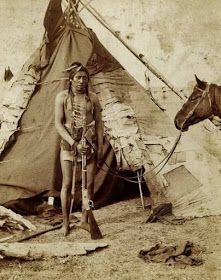 Native American Indian Pictures: Blackfoot/Blackfeet Indian Tipis  1888 photo of a Blackfeet/Blackfoot Indian warrior photographed in front of his tipi.