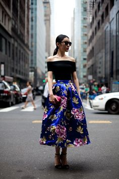 Off the shoulder black top with brilliant blue and floral satin skirt