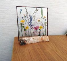 Pressed flower art, pressed flowers in glass, real pressed flowers, on a birch stand, dried pressed
