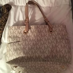 Michael Kores purse, barley used White and tan, comes with matching wallet Michael Kors Bags Totes