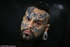 Moody:Body modification and tattoo artist Emilio Gonzalez, who has complemented his facial tattoos with horn-like piercings in his forehead and tunnels in his ears and lower lip