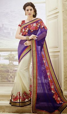 Deep Purple and Cream Net Half N Half Saree Include your self of the glamour of the season with this deep purple and cream net half n half saree. This attire is well designed with dangler, floral patch, lace and stones work. Comes with a matching stitched round neck blouse with 6 inches sleeves. #EmbroideryWorkSareesIndia #FancyDesignerWorkSaree