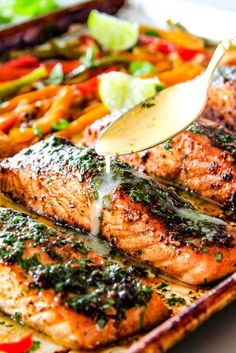 Easy marinated and spice rubbed Sheet Pan Fajita Salmon is incredibly juicy, tender and bursting with flavor all smothered in Cilantro Lime Butter!  Serve with rice and