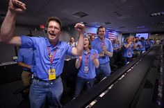 Gallery: Mars Science Laboratory Curiosity Landing Mars Science Laboratory (MSL) GDS Engineer Rob Sweet, left, reacts along with other MSL team members after the MSL rover Curiosity successfully landed on Mars, Sunday, Aug. 5, 2012.