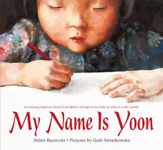 My Name Is Yoon by Helen Recorvits http://www.amazon.com/dp/1250057116/ref=cm_sw_r_pi_dp_WbGoub0E8TMG8
