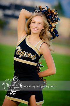 Senior pic idea cheerleading pose cheer photo by Fancy That Photography Gwen Bradbury #fancythatseniors cheer spirit scoreboard poms football field athlete sports senior girl