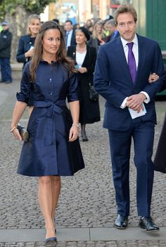 Mourners: Royal in-law Pippa Middleton arrived at the ceremony with sailor Ben Fogle...
