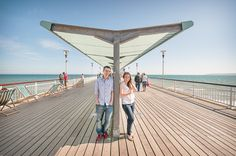 Pre Wedding Photographs on Bournemouth Pier. Photography by one thousand words wedding photographers