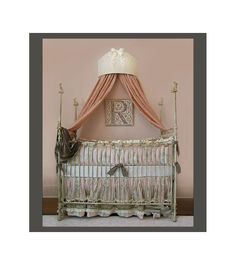 LOVE the Bed Crown and the initial on the wal over the crib :)