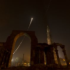 Here's a 34-shot (5-minute interval each) stack of the lunar eclipse trail. Shot on 10th December 2011, at Qutub Minar...