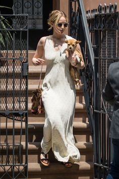 On Jennifer Lawrence:Smoke x Mirrors Rocket 88 Sunglasses($295)  Jennifer Lawrence beating the 90-degree NYC heat with a flowy slip dress, sandals, and her pup Pippi.