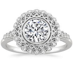 The Alvadora Ring is a truly exceptional vintage-inspired ring with lavishly detailed latticework and a halo of shimmering diamonds. Diamonds sparkle along the shoulders, a beautiful design embellishes the gallery, and the halo shimmers with milgrain detail.