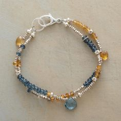 """BUTTERBLUE BRACELET -- Rondelles of butterscotch citrine and blue quartz populate this bracelet's two strands, accentuated with the occasional briolette. Exclusive. Handcrafted in USA. Sterling silver beads. 7""""L."""
