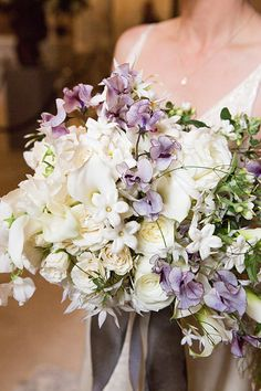 white and lilac bouquet by Lewis Miller Design featuring roses, calla lilies, sweet peas and stephanotis