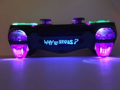 This here is brand new, custom made playstation 4 wireless dualshock 4 controller for the console. This particular design is themed after the JOKERs favorite phrase, Why So Serious? Fitted with transparent green and purple clear buttons thumbsticks a Cool Ps4 Controllers, Ps4 Controller Custom, Game Controller, Control Ps4, Gaming Stand, Custom Consoles, Videogames, Game Room Decor, Room Setup