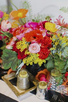Colorful floral centerepice | Milou + Olin Photography | see more on: http://burnettsboards.com/2014/06/anthropologie-j-crew-wedding-style/