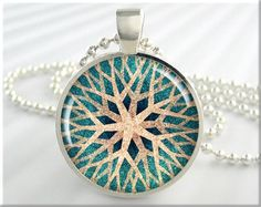 Turquoise Jewelry Necklace Charm. One round silver plated art pendant charm featuring a beautiful complex Snowflake Starburst design plus a matching ball chain necklace.  === See Discount Offers Here === www.etsy.com/shop/MGArtisanPendants/search?search_query=discount&order=date_desc&view_type=gallery&ref=shop_search  These beautiful picture pendants are made by me, one at a time, in my home studio. This one is a pla...