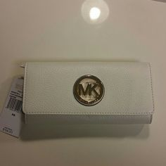 Michael Kors Wallet Michael Kors fulton continental flap wallet Optic white leather with gold hardware New with tags! 100% authentic No trades No holds Michael Kors Bags Wallets