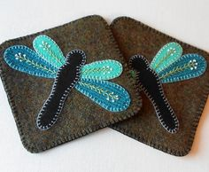 Handmade Wool Dragonflies Mug Mats - 5 1/4 square - set of 2. Stylish! These mug mats have beautiful aqua dragonflies with black bodies on a