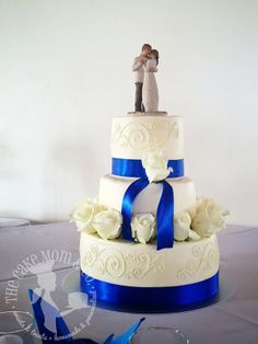Elegant Ivory & Royal Blue Wedding Cake