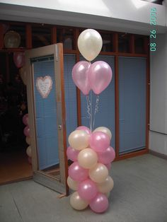 Maybe make the bottom column a diploma, so it's the base of a balloon bouquet.  balloon decoration