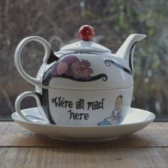 The teapot and cup are hand painted with an Alice in Wonderland themed design that features two quotations from the original book and the characters of Alice and the Cheshire cat in the style of the Disney film. Tea For One, My Tea, Tee Set, Alice In Wonderland Tea Party, Teapots And Cups, Teacups, Coffee Set, Coffee Mugs, Chocolate Pots