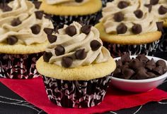 Cupcakes with Chocolate Chip Cookie Dough Frosting - If the icing's your favorite, this cupcake is for you. Moist vanilla cupcakes topped with chocolate chip cookie dough icing. #cookiedough #recipe #cupcake #icing