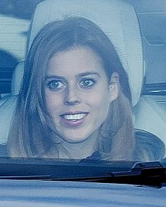 A smiling Princess Beatrice, looked glowing as she arrived for the Queen's festive extravaganza with her extended family