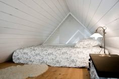 bed in a small loft area.  Usually I see them turned the other direction, but this way the mattress takes up less of the loft space.