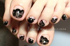See-through black lace nails.