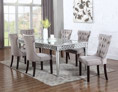 This exclusive Alyssa dining set is chic and sophisticated. The dining table is made of solid wood and silver antique metallic finish with a contemporary design. The table top is beveled and the side panels are decorated with a chic detailed hand applied interlacing circular pattern. The dining chairs are upholstered in suede fabric and made of manufactured wood. Designed with a tufted back and buttoned back frame with espresso color legs.