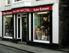 Sleepy Elephant, Sedbergh, Cumbria, UK. The shop specialises in walking boots... and in collectable books. Sedbergh is England's National Book Town. The first book town was founded by Richard Booth in 1961 in Hay-on-Wye (Wales). There are now over twenty towns throughout the world describing themselves as Book towns or Book villages.