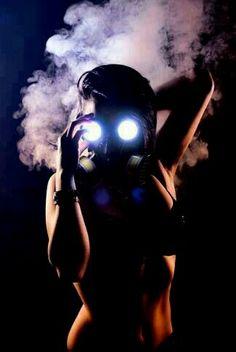 Girl wearing gas mask and black lingerie. Apocalypse Photography, Gas Mask Girl, Plague Mask, Neon Girl, Blowing Smoke, Apocalypse Art, Wonderland, Colored Smoke, Live Wallpaper Iphone