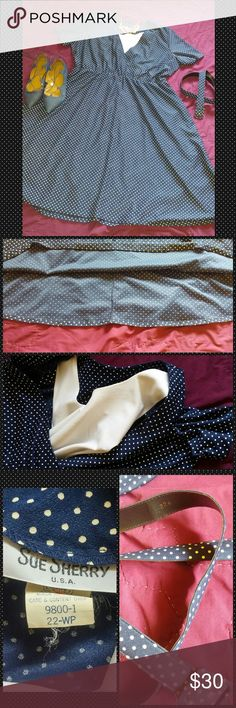 Sue Sherry Vintage Navy & White Polka Dots Sue Sherry Vintage Navy Blue & White Polka Dots  Plus size 22 vintage. In fabulous condition. Should recommend someone with a larger bust and be sure to have a slip as may be itchy and also is a little see through.  This number is a cutie with belt, on belt loop broken, see pics*** For the smaller 22. But has a good amount of stretch, belt may not fit a standard 22. Sue Sherry Dresses Asymmetrical