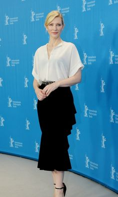 Cate Blanchett wears Givenchy silk crepe de chine top in white with ruffled black matte jersey skirt and sandals also from Givenchy at 'Cinderella' photocall in Berlin on February 13th