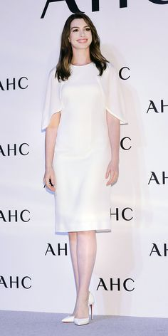Anne Hathaway kept things elegant in a white cape-sleeve dress paired with matching Christian Louboutin pumps Cape Sleeve Dress, Cape Dress, Anne Hathaway Style, Christian Louboutin, Louboutin Pumps, White Cape, Glamorous Dresses, Elegant Woman, Buy Dress