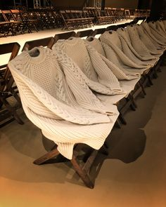 LOCAL WARMING: the seating for ALEXANDER McQUEEN by SARAH BURTON #fw18 collection is made of personalized aran sweaters  @alexandermcqueen #sarahburton #mmparis