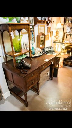 """Late 1800s Oak Desk w/ 5 Pressed Leaf Design Drawer Fronts & Pressed Leaf Panels on back of desk  5' long x 28"""" deep Drawers are 24"""" Deep Restored by Bougainvillea Lane   $625 -- SOLD Aesthetic Movement Walnut Occasional Table w/ Shelf Stretcher  Late 1800s.  $110  - SOLD 1940s Underwood Universal Typermaster Portable Typewriter w/ Case and original instruction manual.  $125 -- SOLD   12"""" Blenko Green Crackle Vase  $39 Available at Adjectives Vintage Market, Altamonte Springs, FL."""