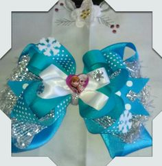 Frozen theme bow made by Norma's Unique Gift Baskets