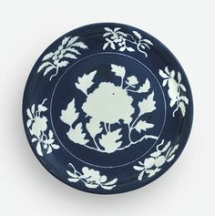 AN EXCEPTIONALLY RARE AND LARGE FINE BLUE AND WHITE RESERVE-DECORATED 'PEONY' DISH XUANDE MARK AND PERIOD
