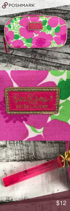 "Lily Pulitzer Pink & Green Small Cosmetic Bag Lily Pulitzer for Estée Lauder pink and green small cosmetic bag with gold trim and pink plastic zipper pull.  8.75"" wide by 4.5"" tall by 2.25"" deep   Perfect for makeup, electronics, medicines, snacks, etc.   Excellent condition. Exterior looks perfect but inside has a few very minor marks. Lilly Pulitzer Bags Cosmetic Bags & Cases"